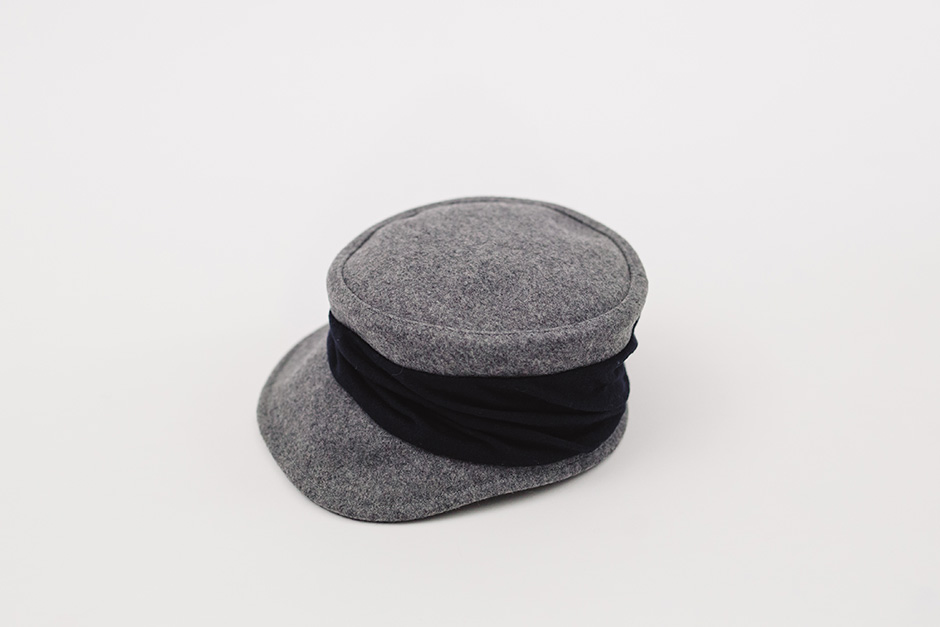 mature ha. melton drape cap