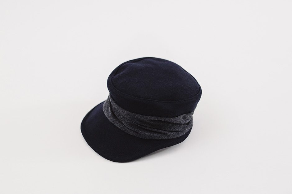mature ha. melton drape cap